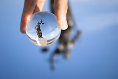 Justice sculpture photo from a glass ball. Stock Images