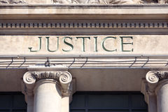 Justice sign on a Courthouse Building, close up Stock Photo