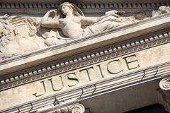 Justice sign on a Courtroom Building, close up. Justice sign on a Courtroom Building royalty free stock images