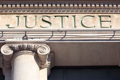 Justice sign on a Courtroom Building, law courts
