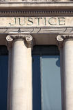Justice sign on a law courts courthouse building, vertical Stock Image