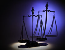 Justice in the spot light. A justice balance under the spot light stock photos