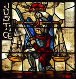 Justice Stained Glass. A single picture representing justice created from multiple glass pieces leaded into position representing the justice that can be stock image