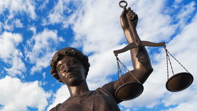 Justice statue. Statue of Justice on the background of running clouds stock footage