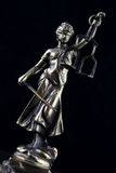 Justice Statue on black background Royalty Free Stock Photo