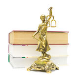 Justice statue and books on white background Royalty Free Stock Image