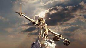 Justice Statue In Dramatic Sunlight