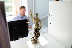 Justice Statue On Shelf At Lawyer Office