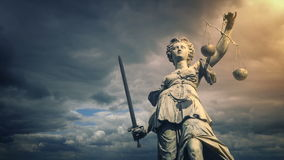Justice statue in sun glow. Statue of Lady Justice illuminated in the sun