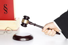 Justice symbol. Wooden gavel and book on a table, justice symbol Royalty Free Stock Photo