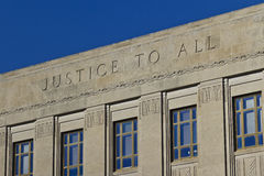 Justice To All atop a Court House Stock Image