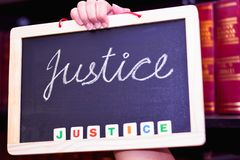 JUSTICE WRITTEN ON A CHALKBOARD royalty free stock photo