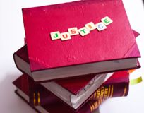 JUSTICE WRITTEN ON LAW BOOKS royalty free stock photo