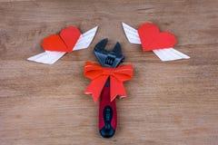 Justierbarer Schlüssel mit Herzen Stockfoto