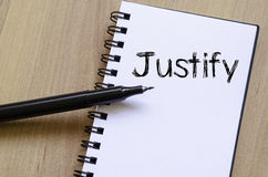 Justify write on notebook Stock Photography