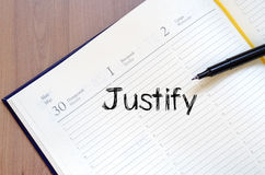 Justify write on notebook. Justify text concept write on notebook with pen Royalty Free Stock Photo