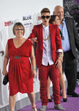 Justin Bieber & Diane Dale & Pattie Mallette & Bruce Dale. LOS ANGELES, CA - DECEMBER 18, 2013: Justin Bieber with grandmother Diane Dale (left), mother Patti stock photography