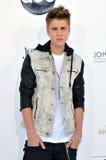 Justin Bieber komt bij de Toekenning van het Aanplakbord van 2012 aan Stock Foto