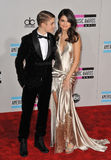 Justin Bieber, Selena Gomez,. Justin Bieber & Selena Gomez arriving at the 2011 American Music Awards at the Nokia Theatre, L.A. Live in downtown Los Angeles Stock Photo