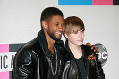Justin Bieber,Usher. Usher, Justin Bieber at the 2010 American Music Awards Press Room, Nokia Theater, Los Angeles, CA. 11-21-10 stock photography