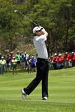 Justin Rose - Iron Shot. Justin Rose, on 1st the fairway, striking the ball with an iron, up toward the green Stock Photos