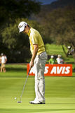 Justin Rose. With his putter in hand, inspecting the path before the ball Stock Photo