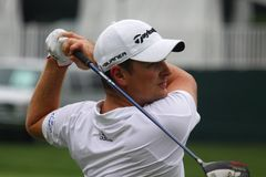 Justin Rose plays a shot Stock Photos