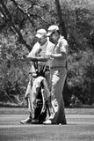 Justin Rose y caddie - NGC2010 Foto de archivo libre de regalías
