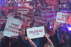 Justin Trudeau election rally. BRAMPTON - OCTOBER 4 : Followers waiving a `Trudeau` sign with during an election rally of the Liberal Party of Canada on October stock photography