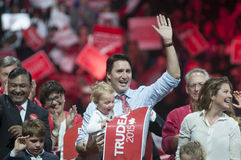 Justin Trudeau election rally. BRAMPTON - OCTOBER 4 :Justin Trudeau with his son and wife waiving towards his supporters during an election rally of the Liberal stock image