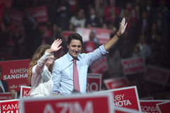 Justin Trudeau election rally. BRAMPTON - OCTOBER 4 :Justin Trudeau and his wife Sophie Grégoire Trudeau waiving towards their supporters during an election Royalty Free Stock Photo