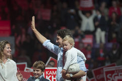 Justin Trudeau election rally. BRAMPTON - OCTOBER 4 :Justin Trudeau while holding his son Hadrien waiving towards the crowd during an election rally of the royalty free stock image