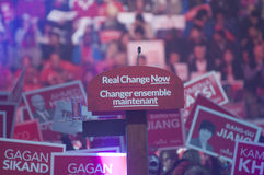 Justin Trudeau election rally. BRAMPTON -OCTOBER 4:`Real Change Now` the tagline of the liberal party being displayed under the microphone in an election rally royalty free stock photography