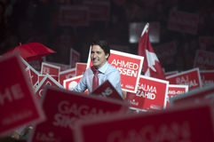 Justin Trudeau election rally. BRAMPTON - OCTOBER 4 :Justin Trudeau shaking hands with his supporters while surrounded by banners during an election rally of the stock photo