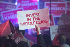 Justin Trudeau election rally. BRAMPTON - OCTOBER 4 :Supporters holding a sign asking to `invest on middle class` during an election rally of the Liberal Party royalty free stock photo