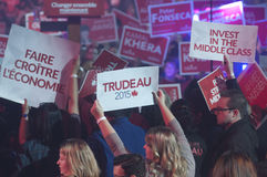 Justin Trudeau election rally. BRAMPTON - OCTOBER 4 :Supporters holding `Trudeau 2015` signs during an election rally of the Liberal Party of Canada on October 4 royalty free stock image