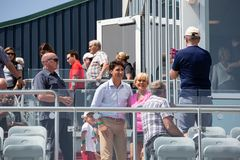 Justin Trudeau posing for selfie. Justin Trudeau, prime minister of Canada, poses for a selfie Charlottetown, PEI while his son, Hadrien, looks on stock image