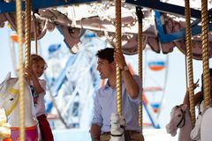 Justin Trudeau Posing for Selfie Tight. Justin Trudeau, prime minister of Canada, and Hadrien ride the miracle go round at the carnival or exhibition in stock photography