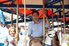 Justin Trudeau Posing for Selfie Tight. Justin Trudeau, prime minister of Canada, and Hadrien ride the miracle go round at the carnival or exhibition in stock image