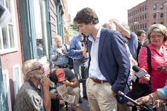 Justin trudeau talks to poor. Justin Trudeau talks with living poor in Downtown Charlottetown during a recent visit to Prince Edward Island's capital. The royalty free stock photo
