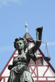 Justitia in front of a house Stock Images