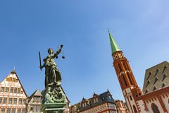 Justitia - Lady Justice - sculpture on the Roemerberg square in Royalty Free Stock Photos