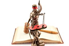 Justitia with law book and paragraph. As justice concept stock images
