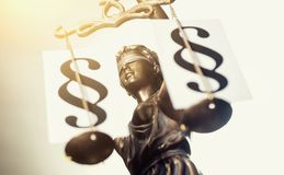 The Statue of Justice - Justitia the Roman goddess of Justice /. Justitia with paragraph signs on scales. ideal for websites and magazines layouts royalty free stock photography