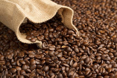 Jute bag on coffee beans. Jute bag on background of coffee beans stock image