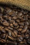 Jute bag with coffee beans Royalty Free Stock Photo