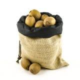 Jute bag with fruits Royalty Free Stock Photos