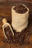 Jute bag full of coffee beans Stock Photos