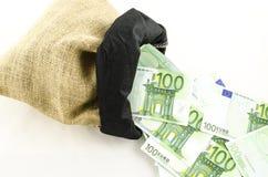 Jute bag full of money. On white background stock images