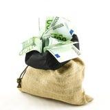 Jute bag full of money Stock Photo